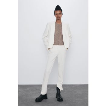 TROUSERS WITH BUTTONED HEMS