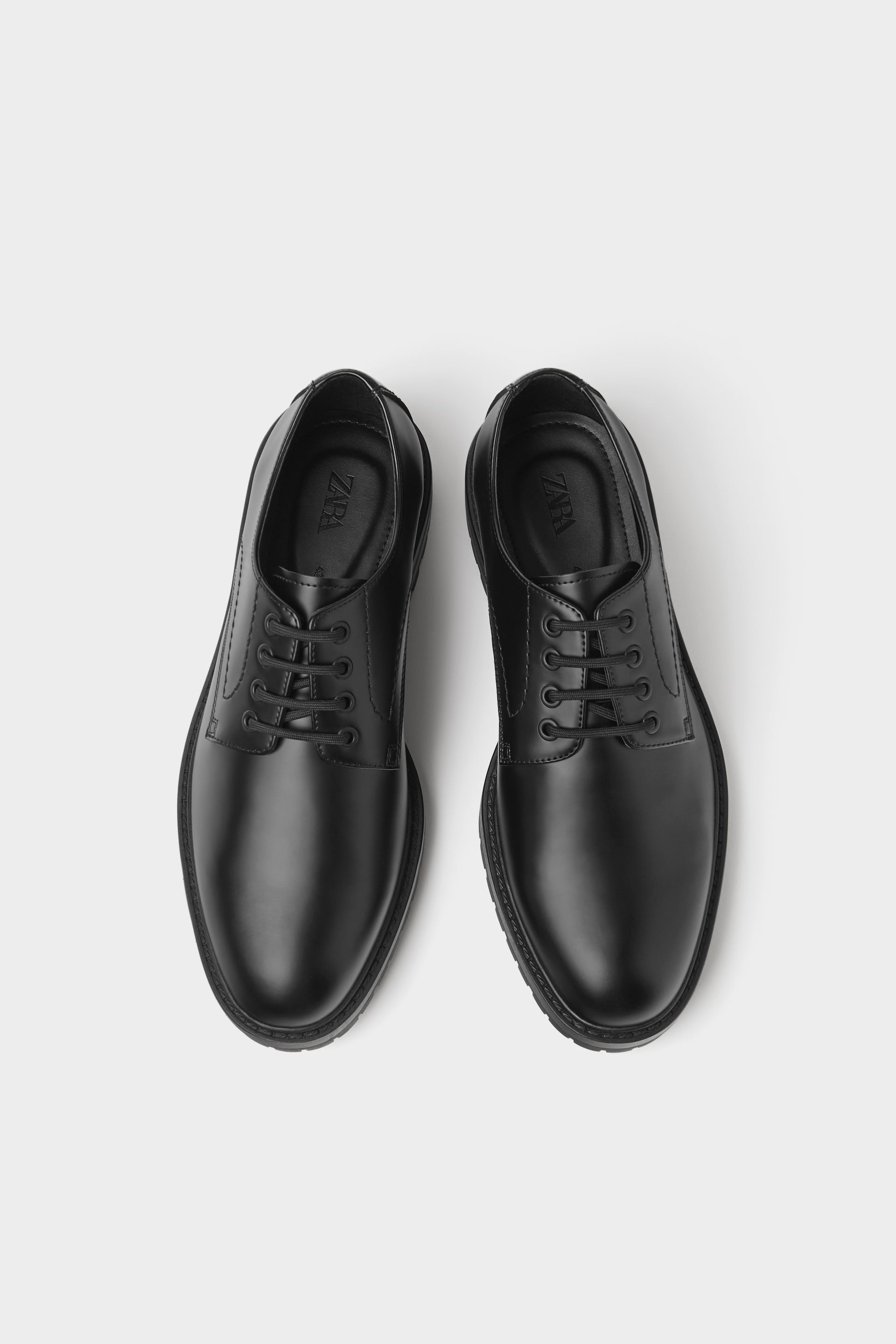 BLACK SHOES WITH TRACK SOLES