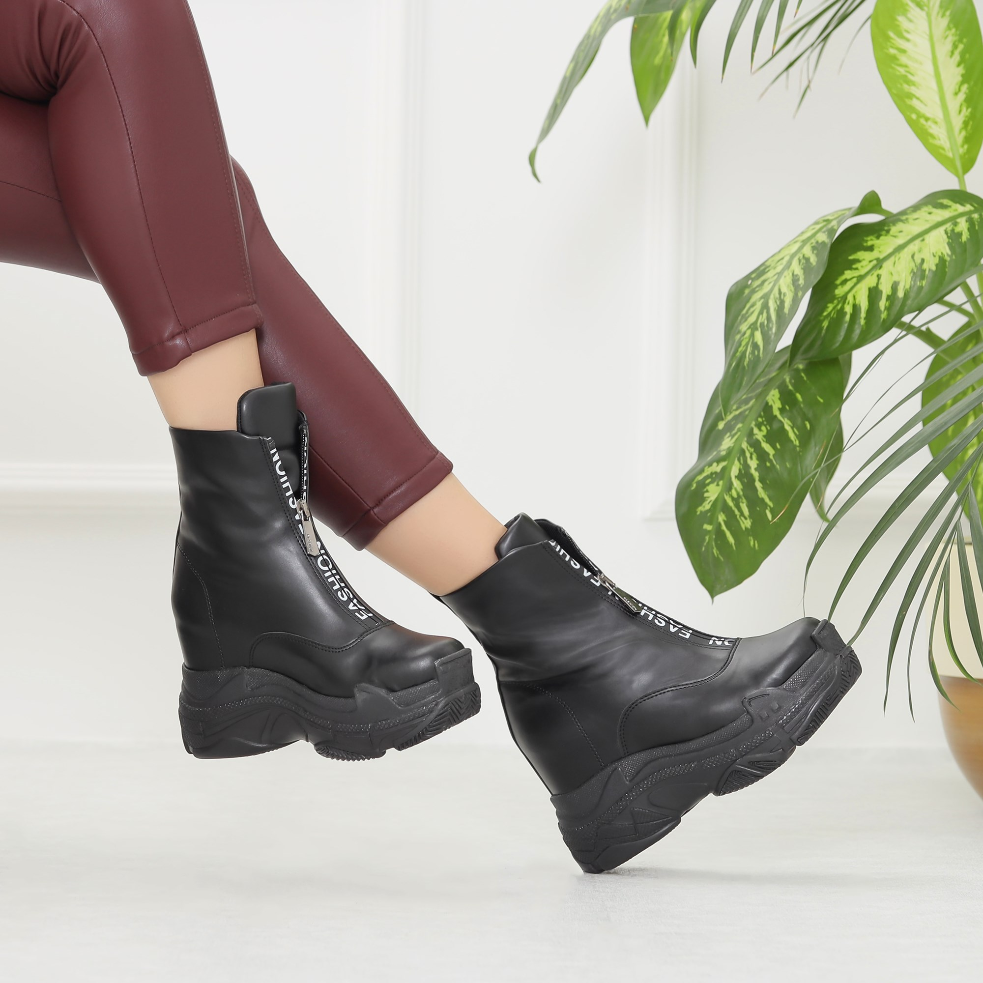 Nigonda Black Wedge Heeled Boots